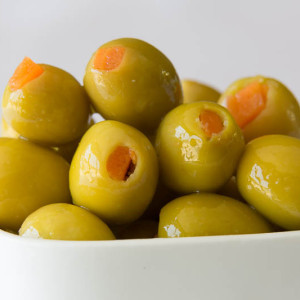 Green stuffed olives with carrot