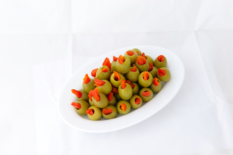 Green stuffed olives with red pepper