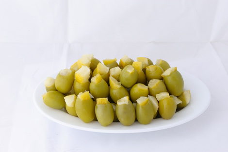 Green stuffed olives with lemon