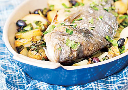 Fish baked with potatoes and olives