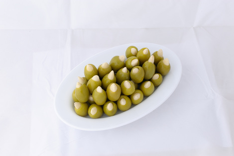 Green stuffed olives with almond