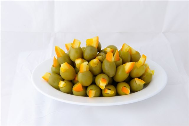 Green stuffed olives with orange